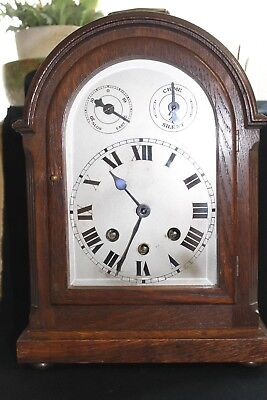 An Edwardian mantle clock with Westminster chimes and silvered dial.