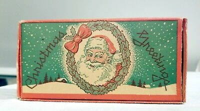 Santa Claus in Holly Wreath. 1900s Cardboard Chocolate Candy Container