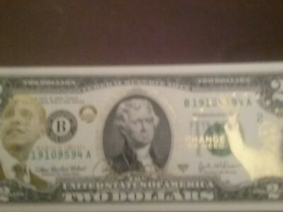 Barack Obama two bill with gold print