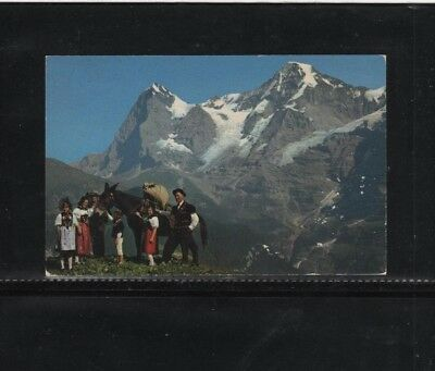 Postcard (Swiss family costumes)---used