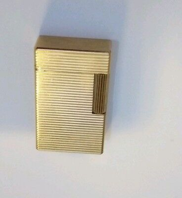 S T Dupont Gold Plated Lighter With Horizontal Lines  circa Mid 1960's