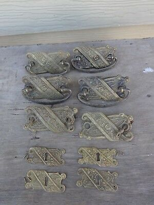 Six Victorian Decorative Pressed Brass Drawer Pulls & 4 Matching Keyhole Plates