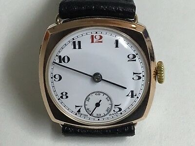 9ct gold vintage cyma movement watch with red number 12 on the dial