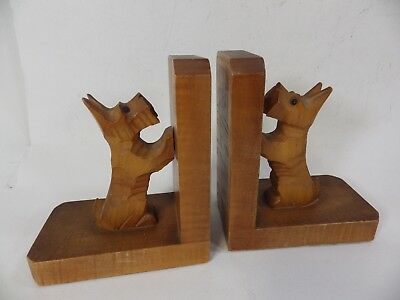 A pair of Vintage Hand Carved Wooden Scottie Dog Book Ends
