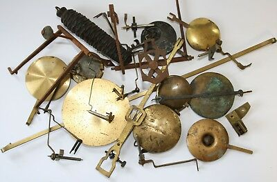 Old vintage clock pendulums and other clock parts job lot