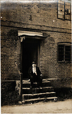 Man with Cat on steps of old Building, old photo postcard, unposted