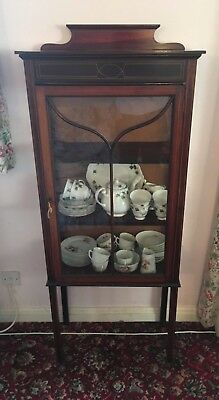 antique display cabinet with inlaid detail on the wood