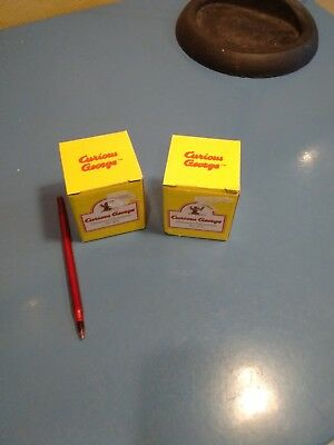 Curious George Christmas Ornaments  ---- 2 boxes