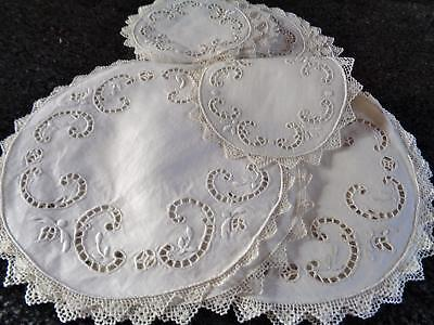 A Superb 24 Piece Antique Linen Table Setting, Cream With Cutwork And Lace Edge