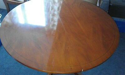 Beautiful Circular Dining Table with Claw Feet on Castors