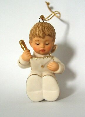 A Berta Hummel White Christmas bisque ornament, accented with 24K gold