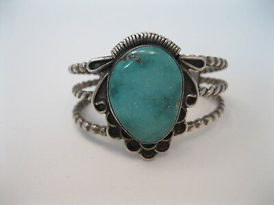 Lot 132 - Vintage Navajo Twisted Silver Wire Bracelet w Turquoise signed
