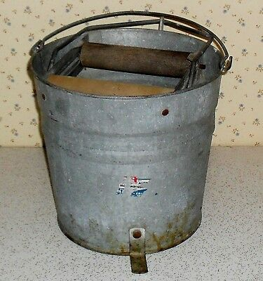 Vintage No. 12 Erie galvanized mop bucket with foot operated rollers