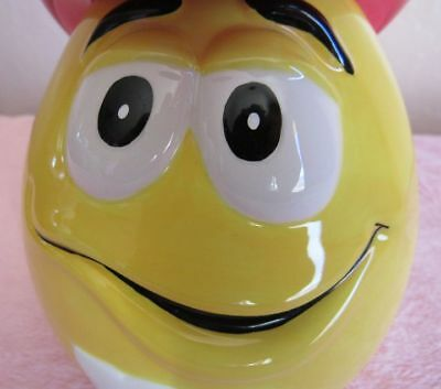 """YELLOW RED HAT  M & M CANDY COOKIE JAR WITH WESTERN HAT. MRK """" MARS c) GALERIE"""""""