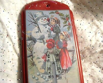 Primitive Style Molded Metal Christmas Thermometer Children Building A Snowman