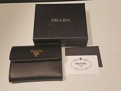 8b725aa76e39 Brand New Prada Black Saffiano Leather W/ Metal Logos Bi-Fold Wallet 1Mh840