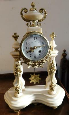 pretty portico french striking mantel clock