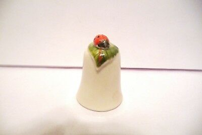 Thimble Porcelain Handcrafted & Painted Hillgrove Ireland Lady On A Leaf Topper