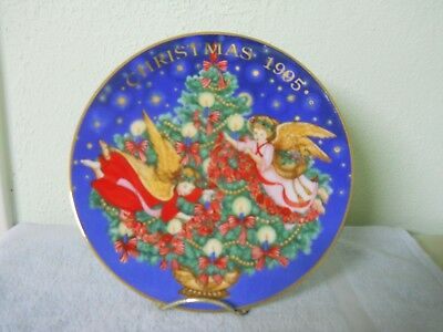 "1995 Avon Christmas Plate ""Trimming The Tree"" Porcelain gold trimmed with box"