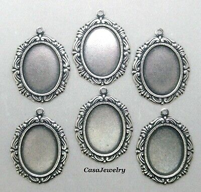 X1153 ANTIQUED SS/P 18X13 BORDERED BEZEL W/TOP HANG RING - 36 Pc Lot (QTY DISC)