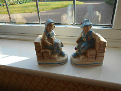 Vintage Art Deco 1930's Pretty Boy & Girl Book Ends Sitting on wall holding book