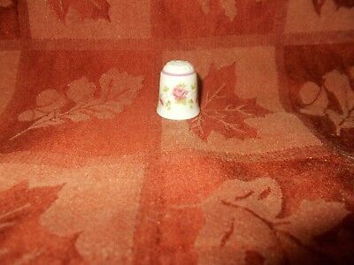 nice pink rose thimble pink band around the top by reutter