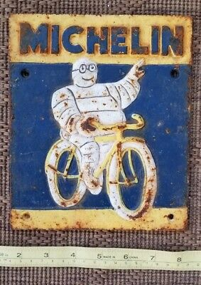vtg MICHELIN AD man bicycle CAST IRON sign plaque rusty rustic old garage 1949