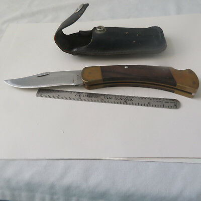 """Knife 4"""" Buck 110  Snap Closed  Light Scratches On The Blade  And A Buck Sheath"""