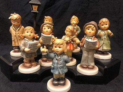 Nine Hummel Figurines In Kinder Choir With Wooden Base And Lamp