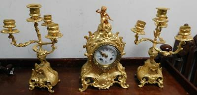 petite french ladies striking clock garniture