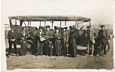 c1915 RPPC Antique Bus Load of Travelers, US / Mexico Border with Sign Postcard