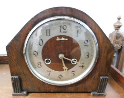 striking oak mantel clock
