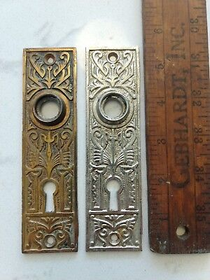 Pair of Antique  Cast Iron, nickel and brass Door Knob Backplates with Keyhole
