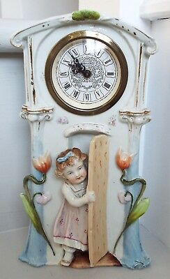 Antique German Porcelain Clock Little Girl stepping out of the clock