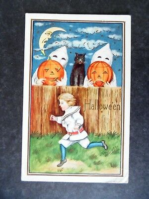 1920s Halloween Greeting Postcard by Whitney Ghosts with Jack O Lanterns