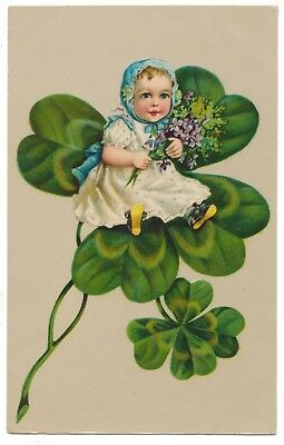 Lucky Baby with Flowers Sitting on Four Leaf Clover