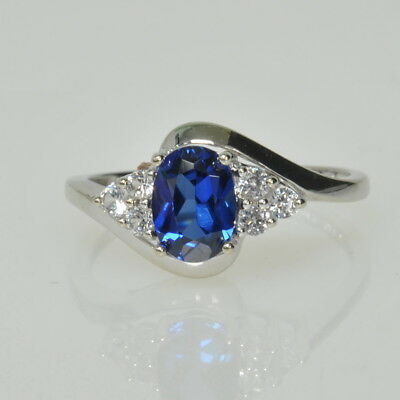 Ladies 10k White Gold Lab Created Oval Cut Blue Sapphire & Cubic Zirconia Ring
