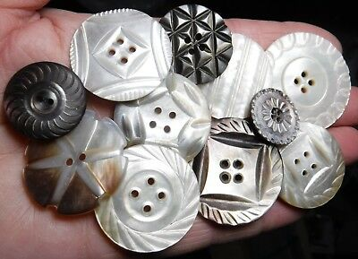 11 Medium and large Pearl/Abalone buttons with carving. 3/4 to 1 & 5/16 inch.