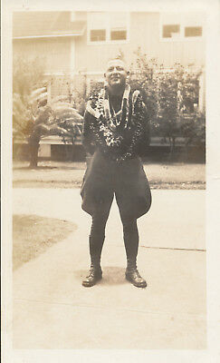 1933   soldier with leis and in shirt & tie in outrigger canoe Hawaii 2 Photos
