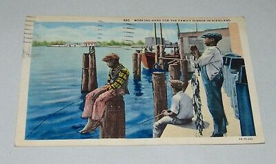ANTIQUE BLACK AMERICANA Postcard WORKING HARD FOR THE FAMILY DINNER IN DIXIELAND
