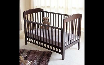 Wooden Baby Cot, outstanding condition and quality with slide down side.