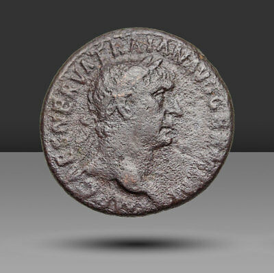 Trajan AE As, Victory left with shield inscribed SPQR