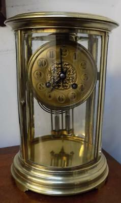 french brass cased oval 4 glass libary clock c1900s