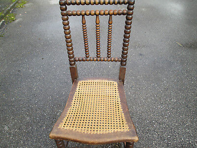 Lat 19th /early 20th century unusual bobbin chair with cane seat.