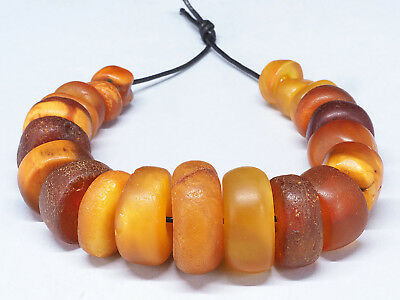 21 Antique natural amber beads. 35 grams. Berber, Morocco. Ethnic tribal jewelry