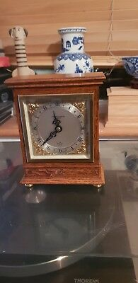 Elliott Clock 8 day with a platform in Oak case MADE IN ENGLAND