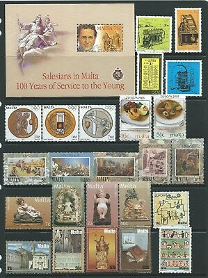 2 scans-Collection of mounted MINT Malta stamps.