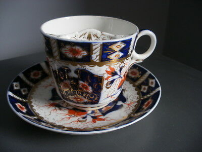 A Gaudy Welsh Moustache Cup And Saucer