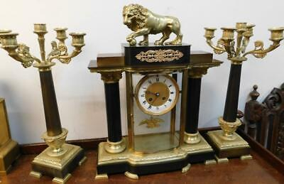 french empire styled bronze and brass mantel clock with lion surmount