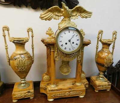 very large french sienna marble and brass mounted clock garniture with eagle top